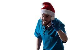 Man Doctor Surgeon In Christmas Santa Hat Royalty Free Stock Image