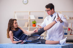 The man doctor taking care of sports injury Stock Images