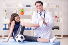 The man doctor taking care of sports injury Royalty Free Stock Photo