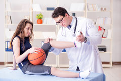 The man doctor taking care of sports injury Royalty Free Stock Photography