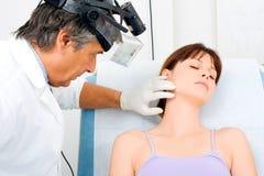 Man doctor visit a young woman Stock Photos