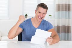 Man With Document At Desk Royalty Free Stock Images