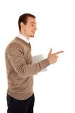 Man with documentation shows direction Royalty Free Stock Photography
