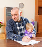 Man  with documents and   daughter Royalty Free Stock Image