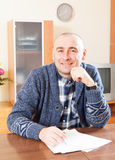 Man   at  documents in  home Royalty Free Stock Images