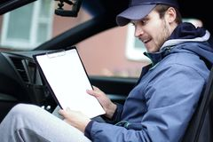 Man with documents sitting in the car royalty free stock photo