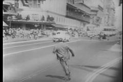 Man dodging traffic on Market Street, San Francisco, California stock footage