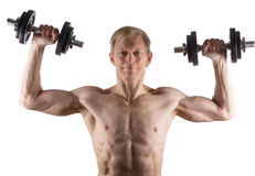 Man does exercise with dumbbells for deltoid muscle Royalty Free Stock Photography