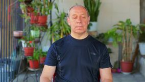 A man does exercises with his eyes in a diagonal motion. The average plan stock video