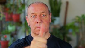 A man does exercises with his eyes looking at his finger and moving it away. Close-up stock video