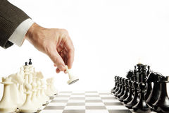 Man does first move in a chess game Royalty Free Stock Photos