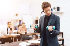 A man does gymnastic exercises at work. royalty free stock photo