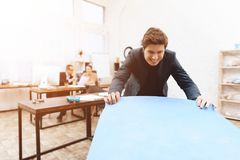 A man does gymnastic exercises at work. royalty free stock image
