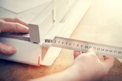 Man does measuring with slide calliper in paper cutter Stock Photography