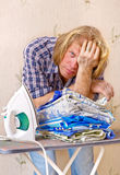 Man does not want ironing clothes Stock Image