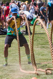 Man Does Rope Whip Workout At Atlanta Field Day Event. Atlanta, GA, USA - July 16, 2016:  A man does a rope whip workout with the tug-of-war ropes while waiting Stock Photo