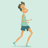 Man does running and listening to music in the player and headphones. Royalty Free Stock Photo