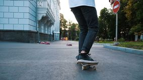 Man does on a skateboard a trick kickflip and fails close up, slow motion stock video