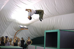 A man does a somersault on the 5th parkour contest Royalty Free Stock Images