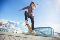 Free Man Does Trick On Skateboard Royalty Free Stock Image - 117620426