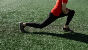 Man does workout on stadium lawn stock footage