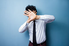 Man doesn't want his photo taken Royalty Free Stock Photo