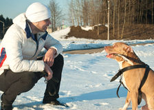 A man with a dog Stock Images