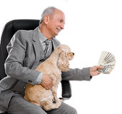Man and dog. Senior businessman with money and dog sitting on office chair on white background Royalty Free Stock Photos