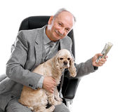 Man and dog. Senior businessman with money and dog sitting on office chair on white background stock images