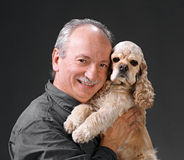 Man and dog. Happy man with a dog on a gray background Stock Images