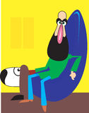 Man and dog. A beardy man is relaxing in a cushion chair and dog beside Stock Images