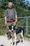 Man with a dog at the animal shelter. Lugano, Switzerland - 11 November 2002: man with a dog at the animal shelter of Lugano on Switzerland royalty free stock image