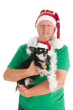 Man with dog as Santa Claus Royalty Free Stock Photo