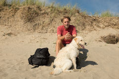 Man and dog on beach. Stock Photos