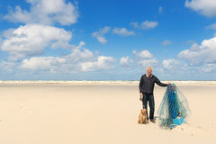 Man with dog at the beach Royalty Free Stock Photos