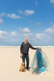 Man with dog at the beach royalty free stock image