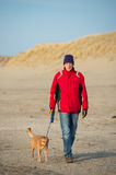 Man with dog at the beach Stock Photos
