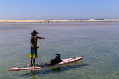 Man and dog in the board,port stephens,australia Stock Photo