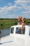 Man and dog in boat Royalty Free Stock Photography