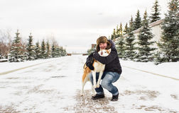 Man with dog of breed husky in winter on the snow Royalty Free Stock Images