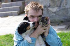 Man with dog and cat Royalty Free Stock Photo