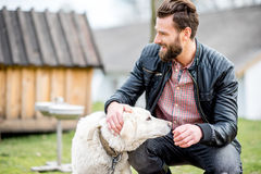 Man with dog at the countryside royalty free stock images