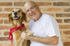 Man and dog friends Stock Images