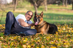 Man With Dog German Shepherd Stock Photo