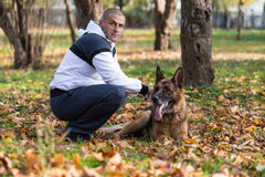 Man With Dog German Shepherd Royalty Free Stock Photography