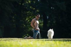 Man With Dog German Spitz royalty free stock photo