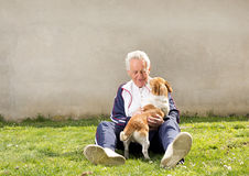 Man with dog on grass Royalty Free Stock Photo