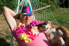 Man with dog in hammock Royalty Free Stock Image