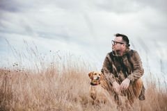 Man and dog in high grass Stock Photography