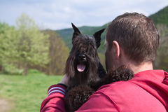 Man and dog. Man and his dog miniature schnauzer black Stock Photography